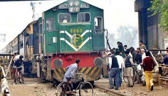 18 killed after passenger train rams into bus in Pakistan