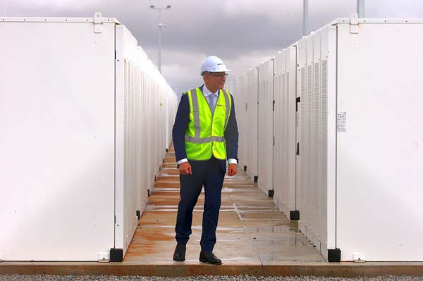 South Australian Premier, Jay Weatherill walks around the compound housing the Hornsdale Power Reserve, featuring the world's largest lithium ion battery.