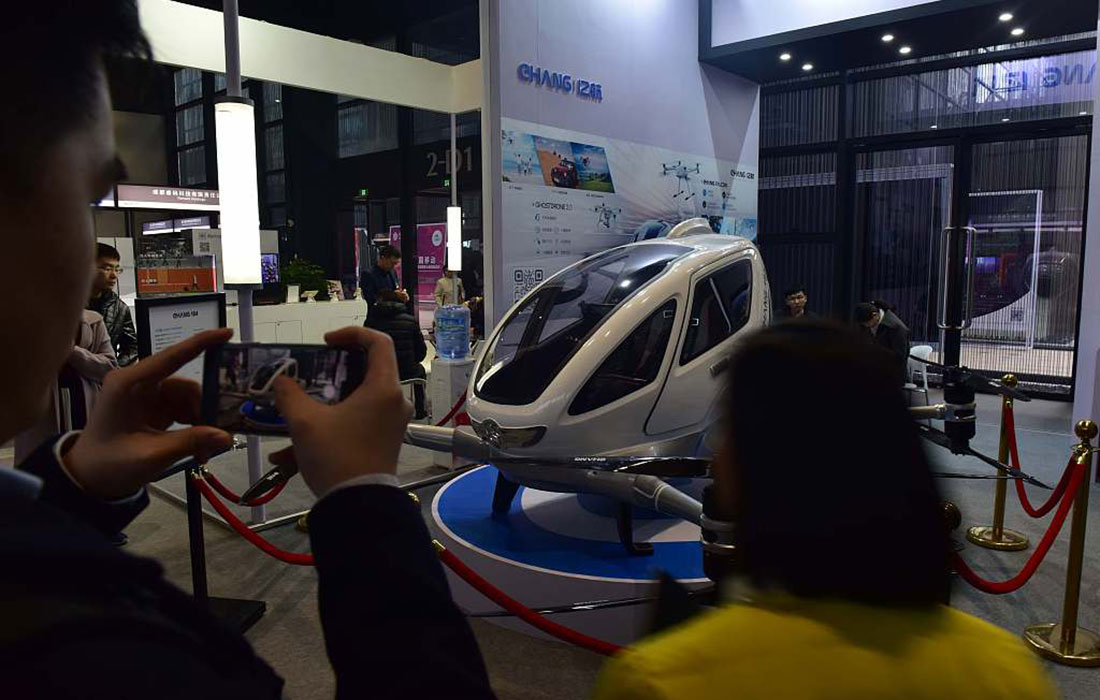 Visitors view an intelligent single-seat aircraft on display at the Fourth World Internet Conference.