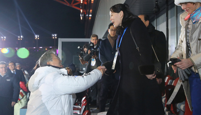 Kim Jong Un's sister, South's President Moon shake hands at Olympic opening