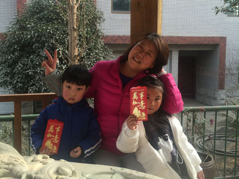 Ms Hanna with her grandchildren celebrating Spring Festival in Ankand city, China.