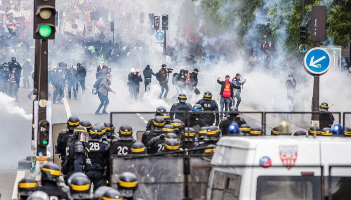 Protesters Flee Police During May Day Protests in Paris