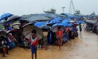 Landslides kill 12 as monsoon batters Rohingya refugees