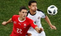 Swiss through to last 16 but lose captain Lichtsteiner