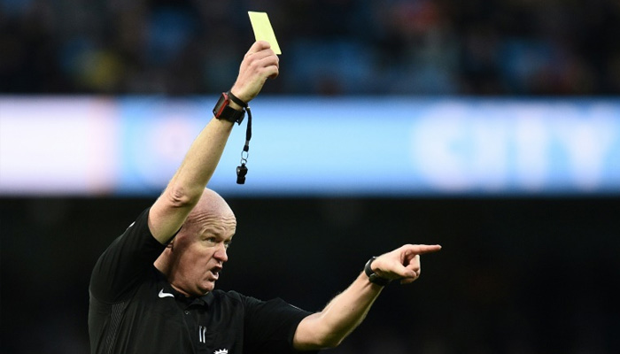 Now red and yellow cards for managers too