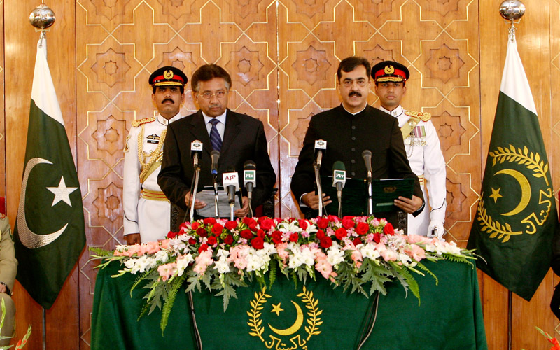 Former president Pervez Musharraf, front left, administers oath to PM Yousaf Raza Gilani on March 25, 2008.