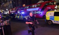 Woman held after UK knife attack sparks terror fears