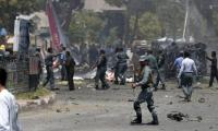 At least 32 killed in suicide attack on Afghan protesters