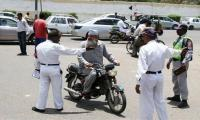 Traffic police in action against commuters going wrong way
