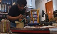 Pakistani artist aims for record with pencil swing