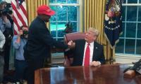 Kanye West hugs Trump, muses on presidential run