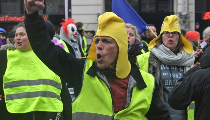 Yellow vest are joined by pink-jacketed gender equality campaigners