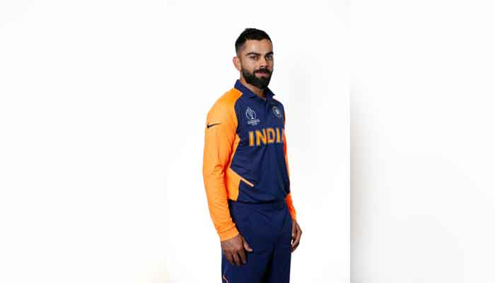 Kohli gives thumbs-up to India's orange jersey
