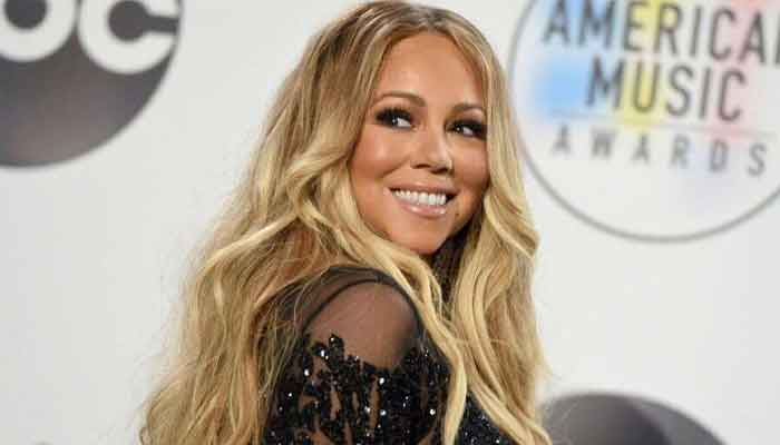 Mariah Carey tops the Billboard charts in four decades