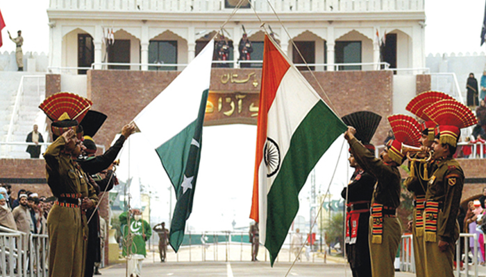 Pakistanis stranded in India due to virus lockdown return home via Wagah border
