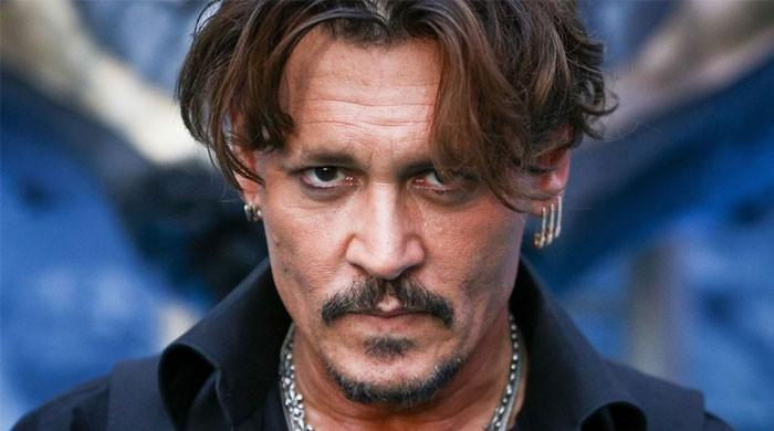 Johnny Depp takes witness stand, claims Amber Heard hit him