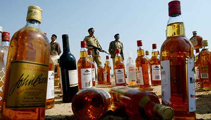 Indian police crackdown on illegal liquor suppliers after 86 die