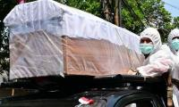 Indonesia coffin parade urges people to be careful as coronavirus rages on