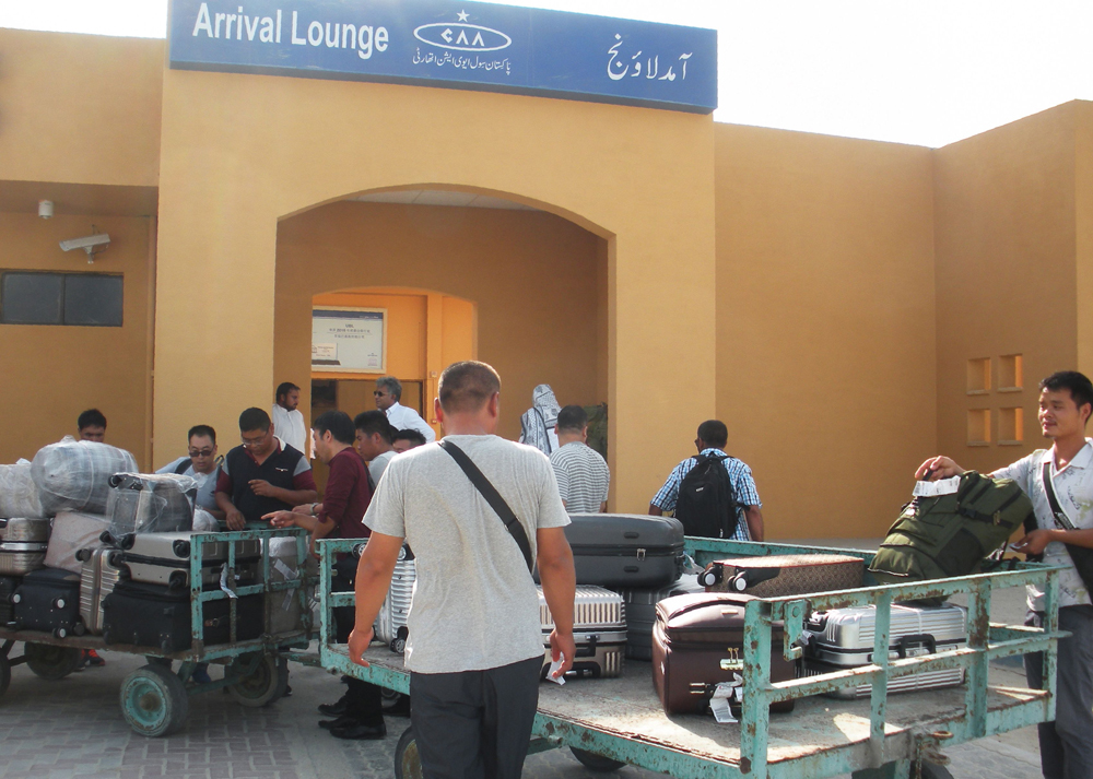 Chinese nationals wait to receive luggage after arriving at Pakistan´s Gwadar port.