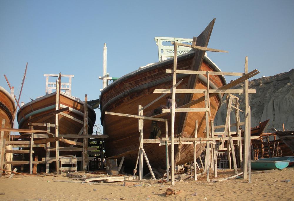 Pakistani fishermen construct a boat in Gwadar port.