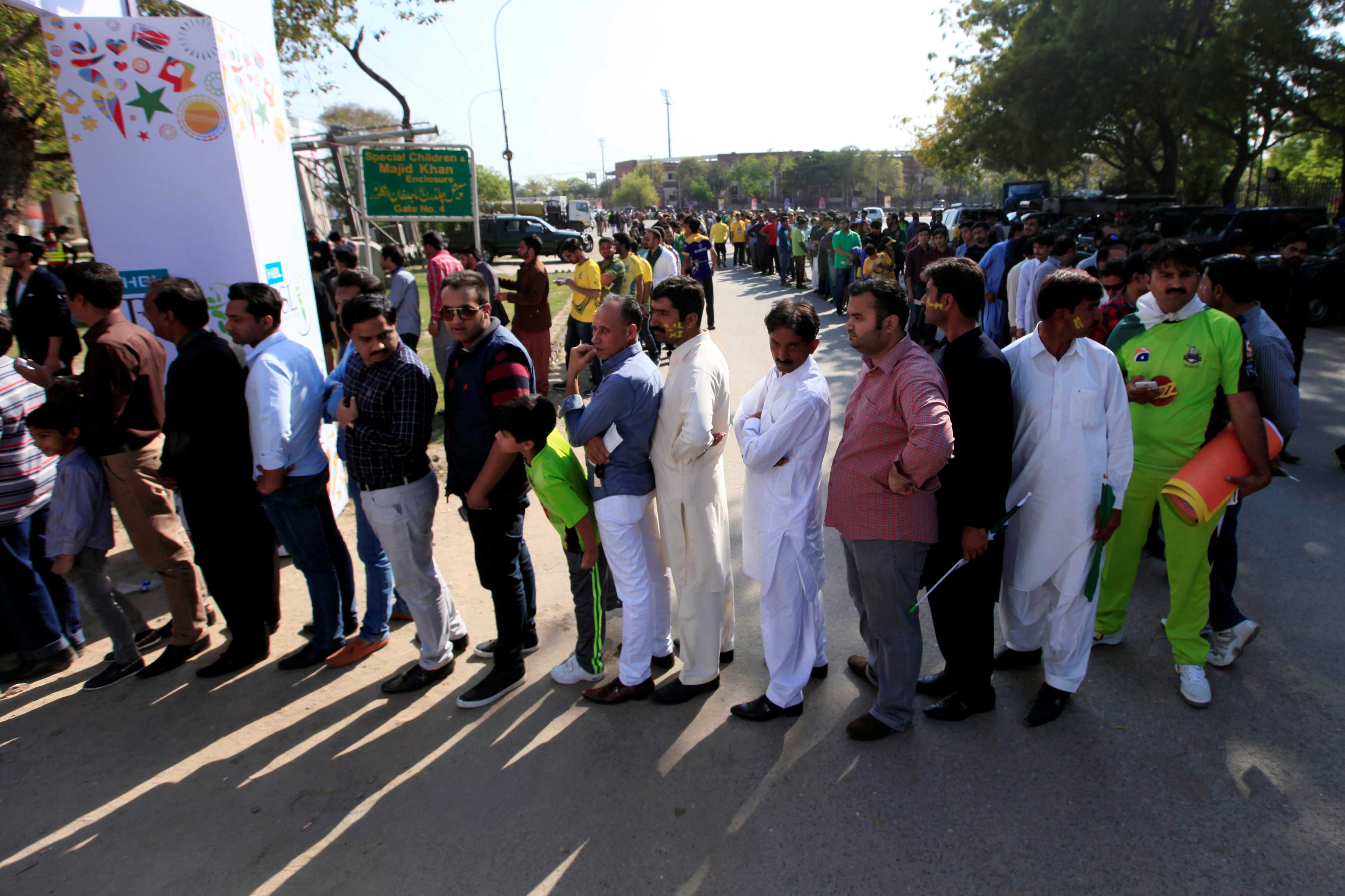 Spectators wait for their turn to enter Gaddafi Cricket Stadium to watch hugely anticipated final of  the Pakistan Super League (PSL) in Lahore. -Reuters