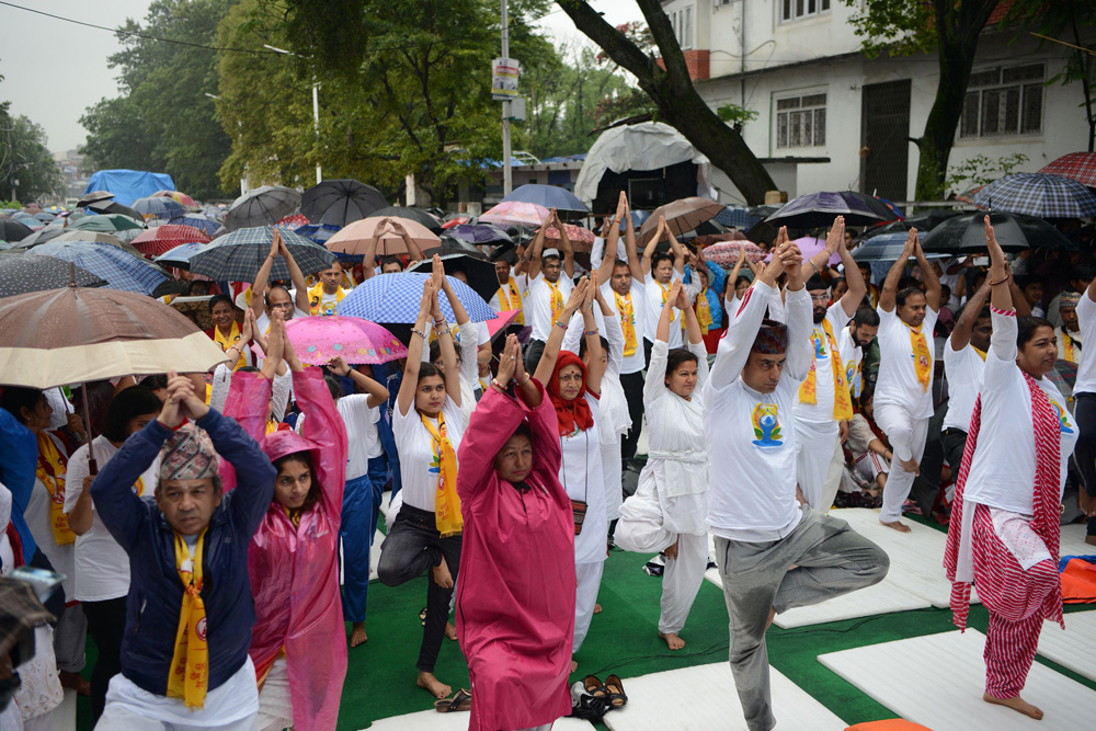 Thousands stretch and pose for International Yoga Day