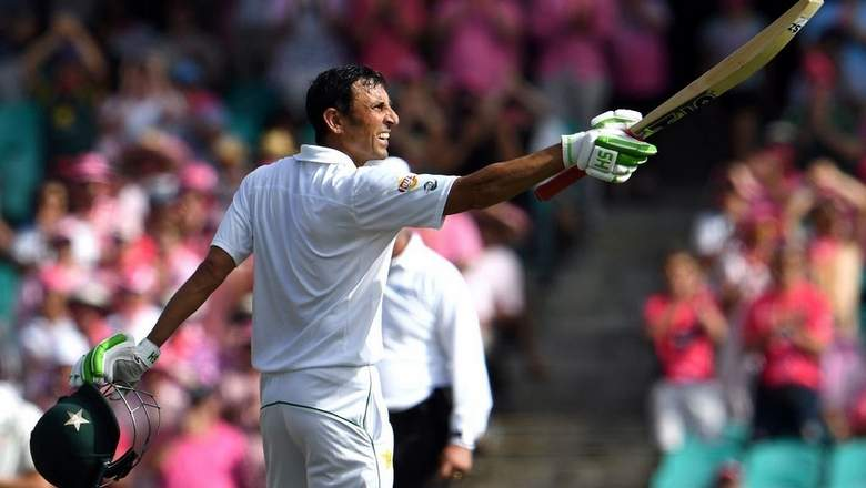 Younis Khan raises bat after scoring century against Australia in January 2017. With this ton, he became the first cricketer to score Test centuries in 11 countries.