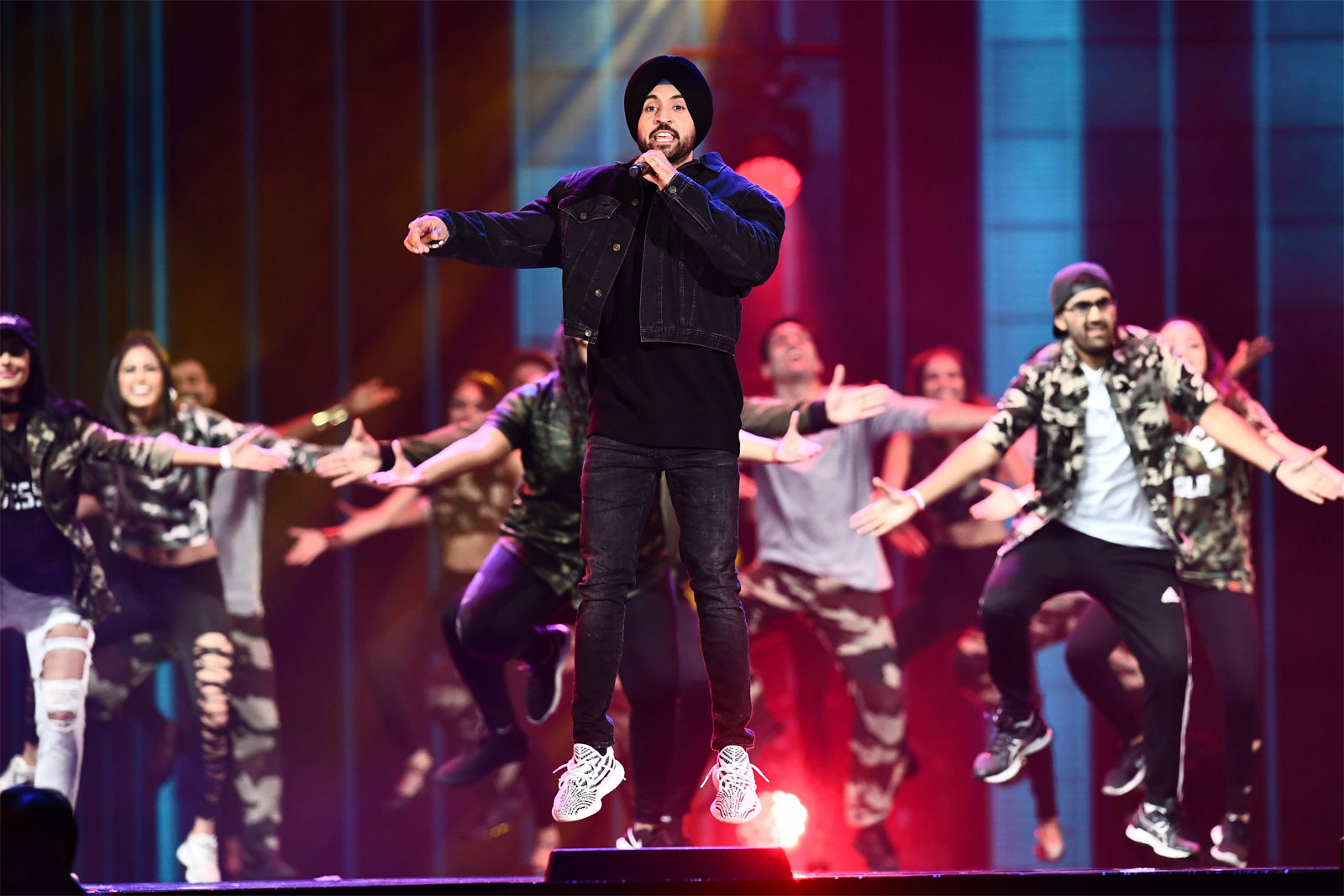 Singer Diljit Dosanjh performs on stage during IIFA Awards 2017/AFP
