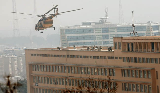 Afghan National Army (ANA) soldiers descend from helicopter on a roof of a military hospital during gunfire and blast in Kabul