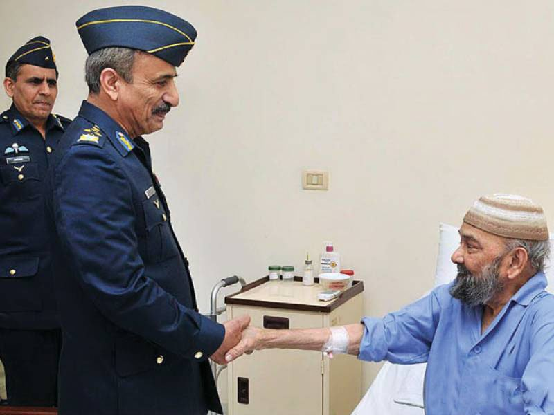2013 file photo shows then Chief of the Air Staff, Air Chief Marshal Tahir Rafique Butt meeting Air Commodore (r) MM Alam.