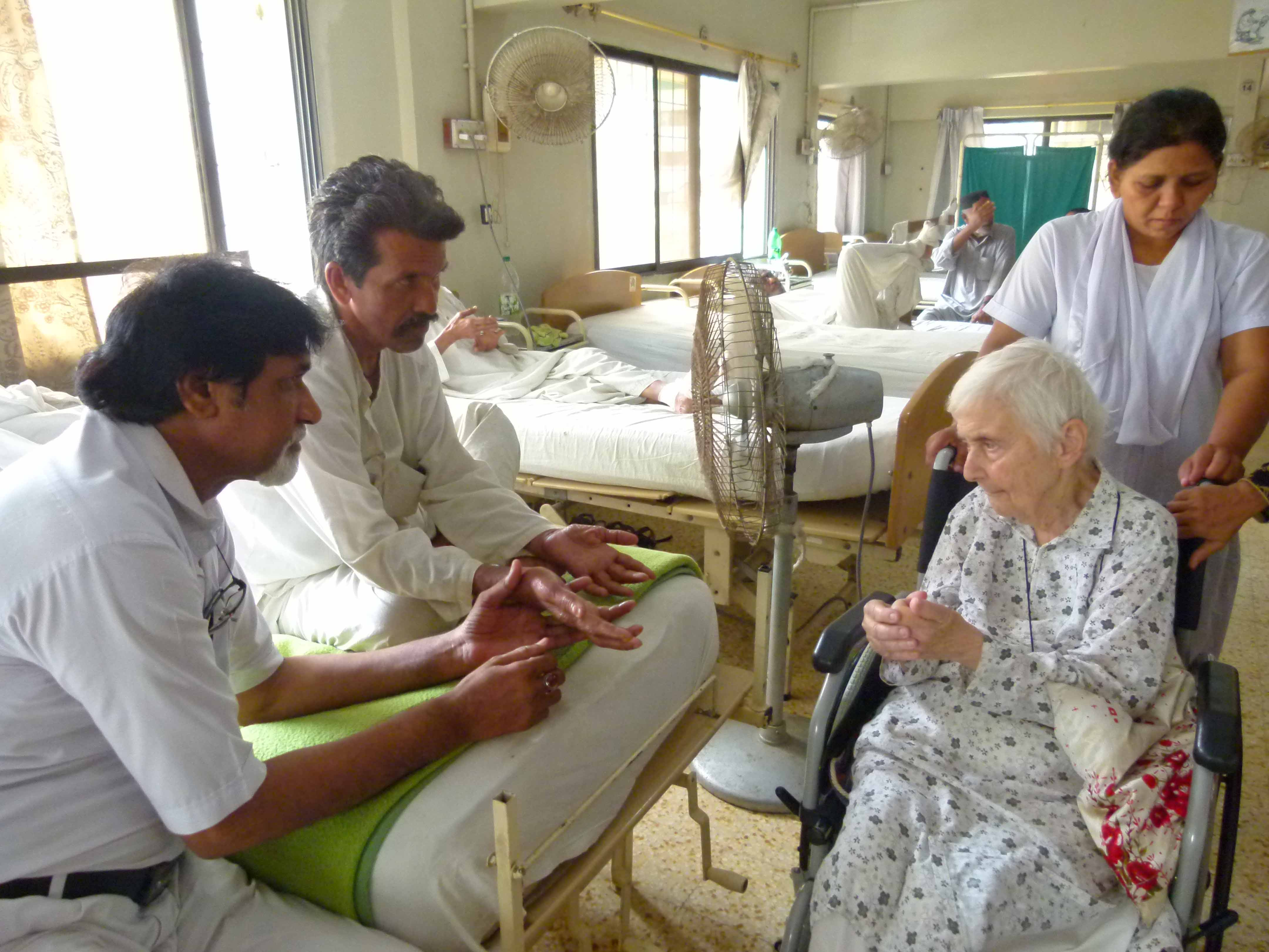The last day of Dr. Pfau at MALC - Teaching a patient hand exercises during ward visit on 06 August 2017.