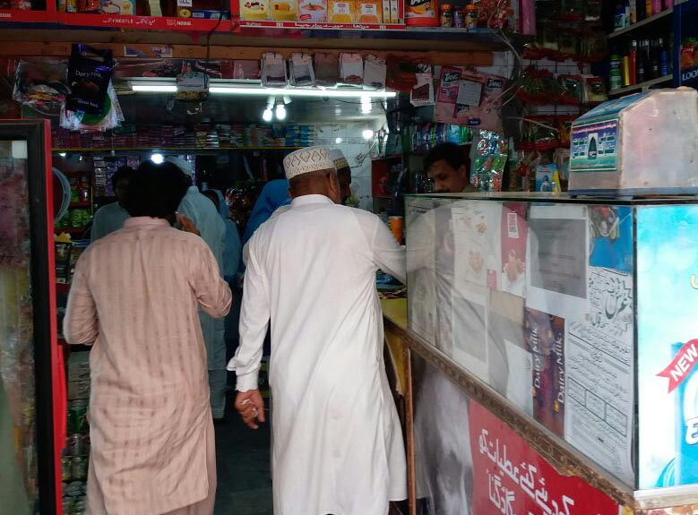 Bohra visitors at a shop in Saddar.