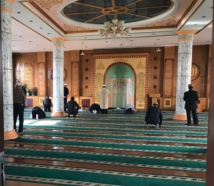 Uighur Muslims performing Zuhar prayer at a Mosque in Urumqi. Photo by author