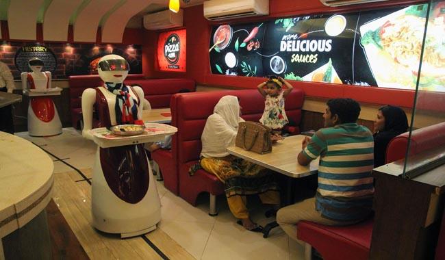 A robot waitress delivers food