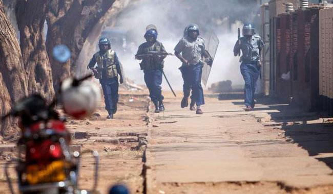 Zimbabwe police fire tear gas, beat anti-Mugabe marchers
