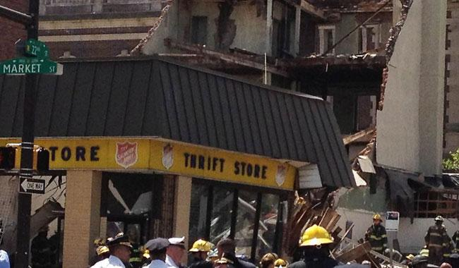 One killed, 13 hurt in building collapse