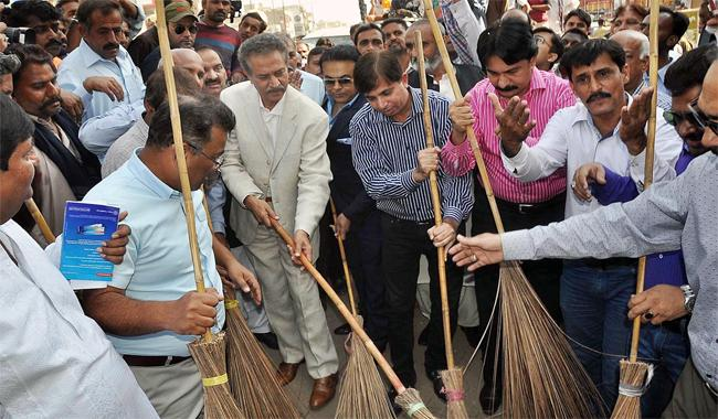 Broom in hand, mayor kicks off clean-up drive