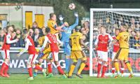 Ton-up Walcott ends Sutton's FA Cup dream