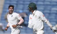 Paceman Umesh takes four as India restrict Australia