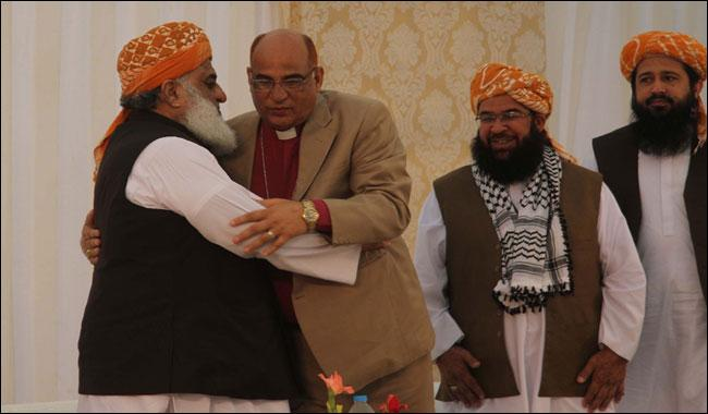 With a bishop on board, JUI-F paddles on its 'soft image' boat