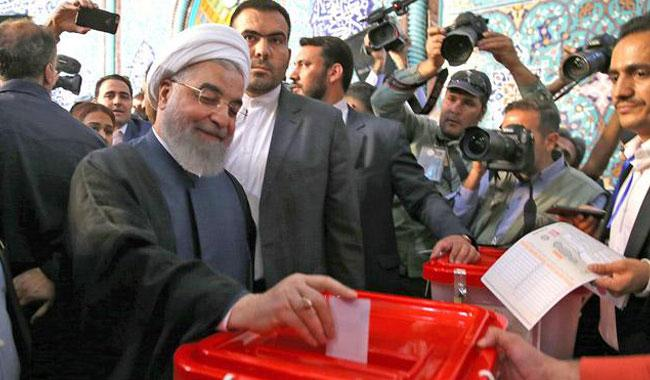 Rouhani faces strong hardline challenge Iranians queue to vote