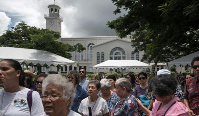 Guam residents pray for peace