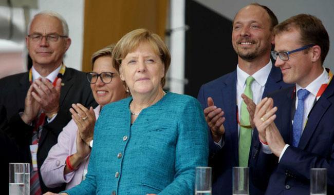 Turkey's Erdogan calls on expats to vote against Germany's Merkel