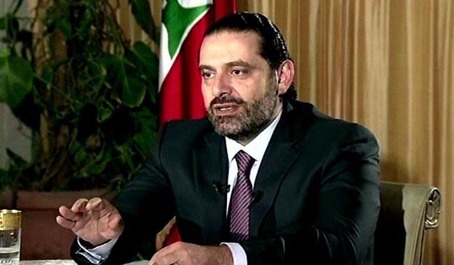 Hariri says free in S Arabia and will return home 'soon'