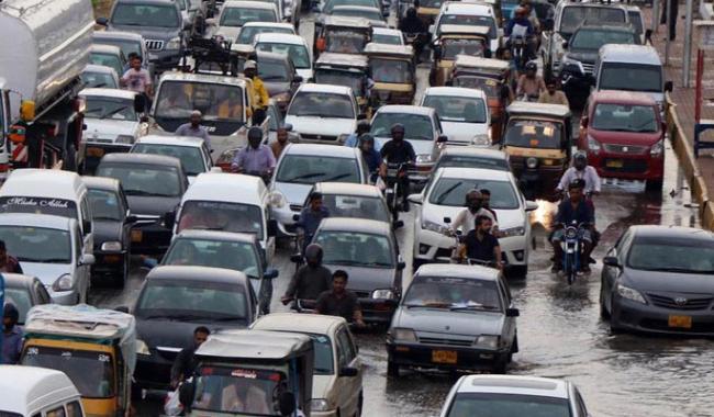 Heavy rain causes long tailbacks on many roads