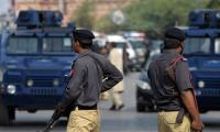 Political workers, gangsters among 15 held