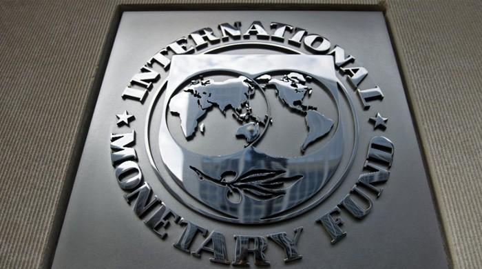 IMF warns of risks as central banks tighten