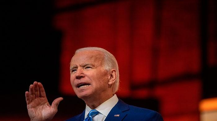 How does President Joe Biden plan to fight climate change?