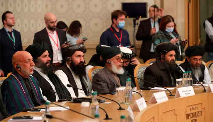 Russia, US push Afghan enemies to accept interim govt