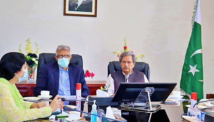 Special Assistant to the Prime Minister on Health Dr. Faisal Sultan and Federal Education Minister Shafqat Mahmood chairing a meeting here on Thursday.